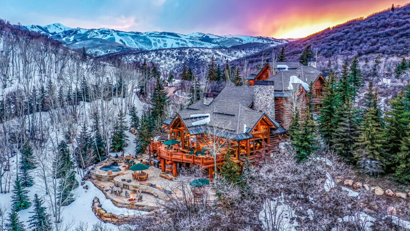 Spanning 16.5 acres, the mountain retreat centers on a cabin-style mansion of more than 12,000 square feet.