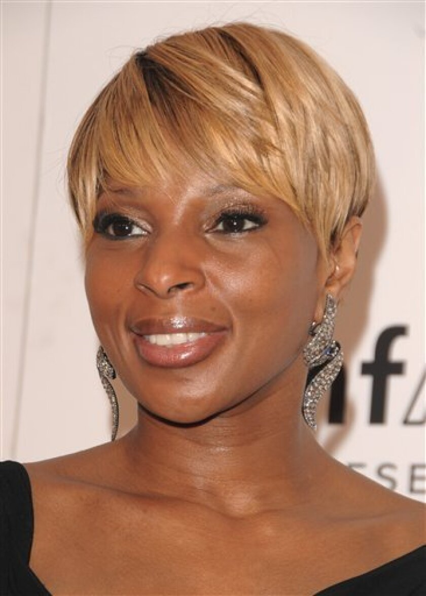 FILE - In this Feb. 12, 2009 file photo, singer Mary J. Blige arrives at a amfAR gala to kick off fashion week in New York. (AP Photo/Peter Kramer, file)