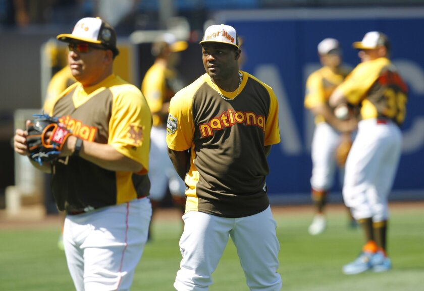 Fernando Rodney looks at Bartolo Colon during All-Star Game practice at Petco Park.