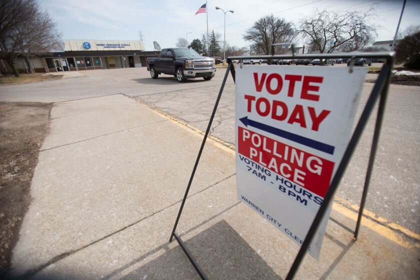 A truck leaves a polling place in Warren, Michigan on March 8, the day Michigan residents voted in their presidential primary.