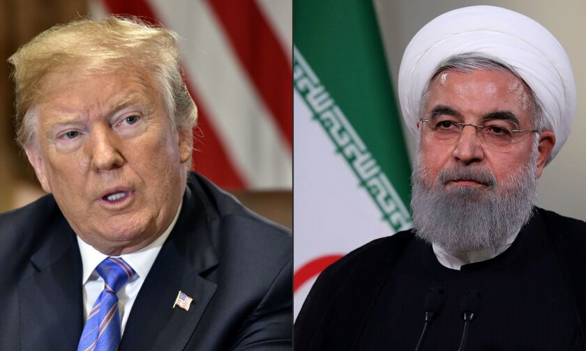 President Donald Trump said July 30, 2018, that his is willing to meet with Iranian President Hassan Rouhani, right.