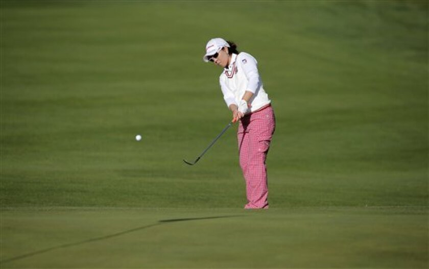 Mika Miyazato, of Japan, plays on the 1st hole during the second round of the Evian Championship women's golf tournament in Evian, eastern France, Saturday, Sept. 14, 2013. (AP Photo/Laurent Cipriani)