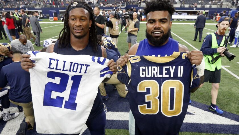 FILE - In this Oct. 1, 2017, file photo, Los Angeles Rams' Todd Gurley, left, and Dallas Cowboys' Ez