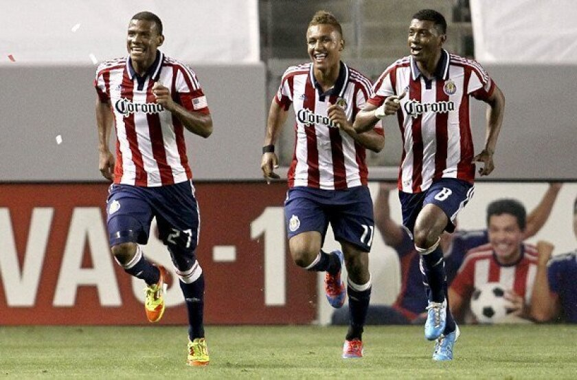 Chivas USA players Jose Erick Correa, left, Juan Agudelo and Oswaldo Minda celebrate after Correa converted a penalty kick against the Galaxy during an MLS game at Home Depot Center last season.