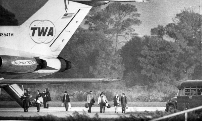 Passengers disembark in Tampa Fl, from a TWA flight that was hijacked in New Mexico. The plane refueled in Tampa and then flew on to Havana.