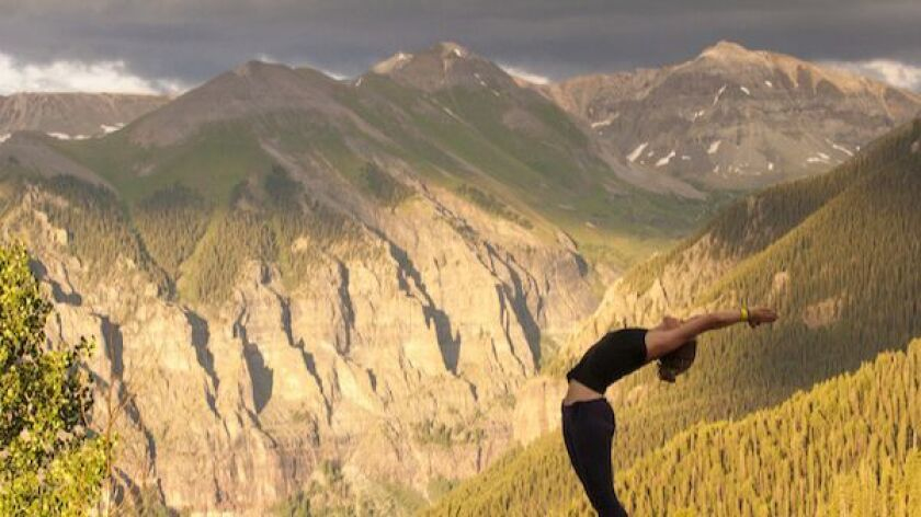 Speciality classes against the San Juan Mountains include some on handstands and arm balance.