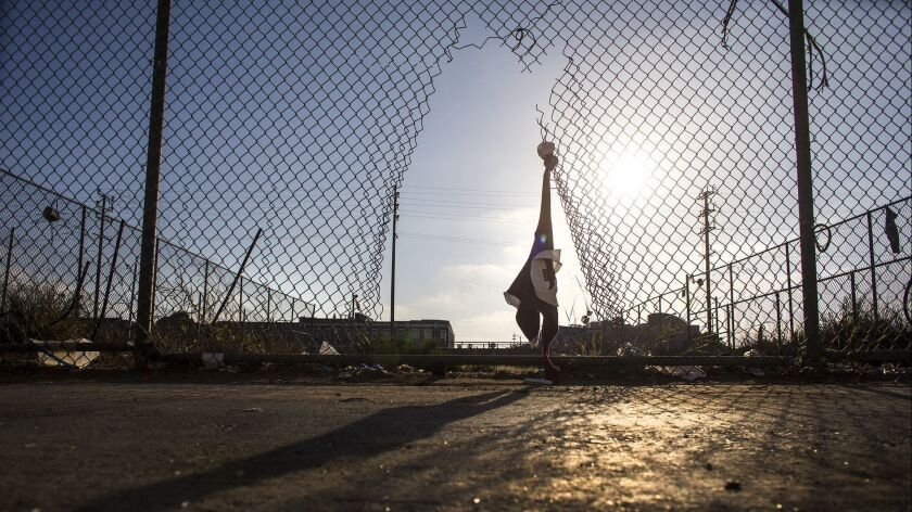 LOS ANGELES,CA - MAY 27, 2016: Torn fencing, tattered clothing and garbage are all that remain in th