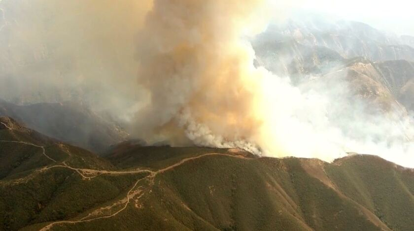 The fast-moving Silverado fire burns Monday in the hills of the Cleveland National Forest.