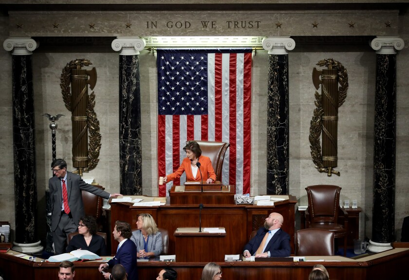 House Speaker Nancy Pelosi gavels the close of the vote on Oct. 31 that formalized the impeachment inquiry into President Trump.