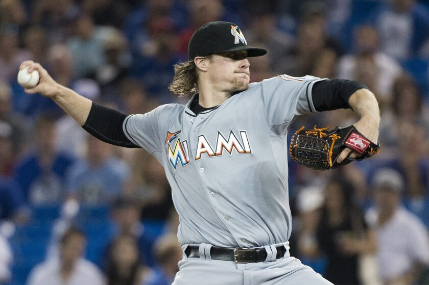 Miami Marlins starting pitcher Tom Koehler works against the Toronto Blue Jays during first inning of a baseball game in Toronto, Wednesday, June 10, 2015. (Nathan Denette/The Canadian Press via AP) MANDATORY CREDIT