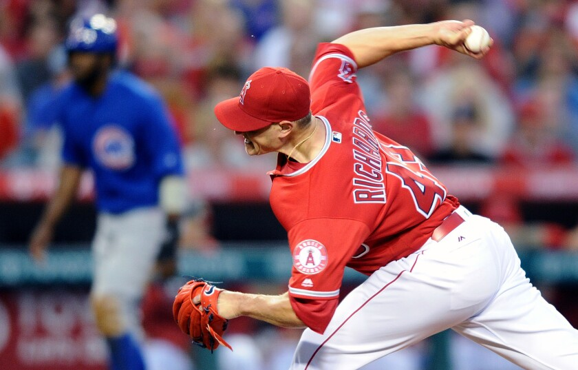 Garrett Richards, pitching for the Angels against the Chicago Cubs in April, is working back from a torn elbow ligament.