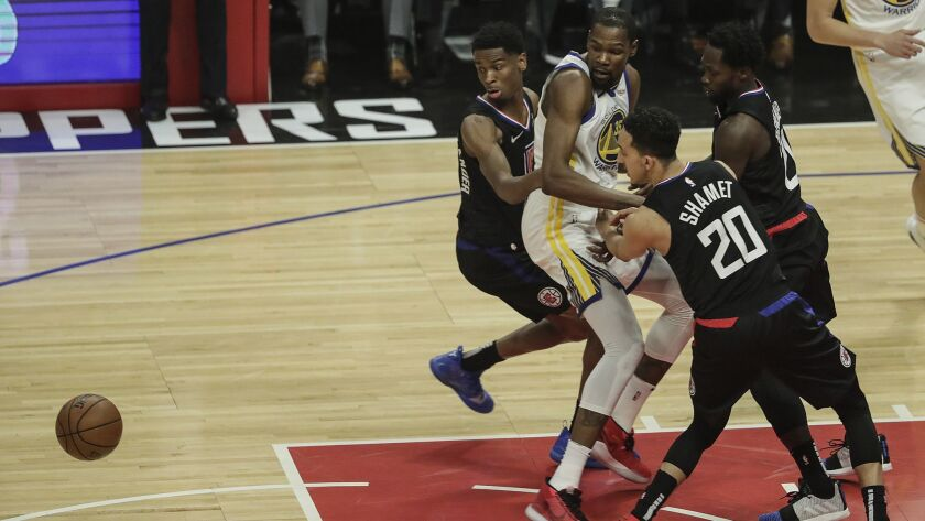 LOS ANGELES, CA, THURSDAY, APRIL 18, 2019 - Clippers defenders knock the ball from Warriors forward