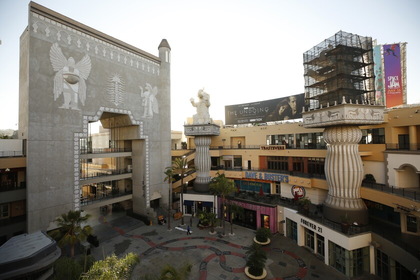 An elevated view shows a faux Babylonian gate and elephants on columns, one of which is covered in scaffolding