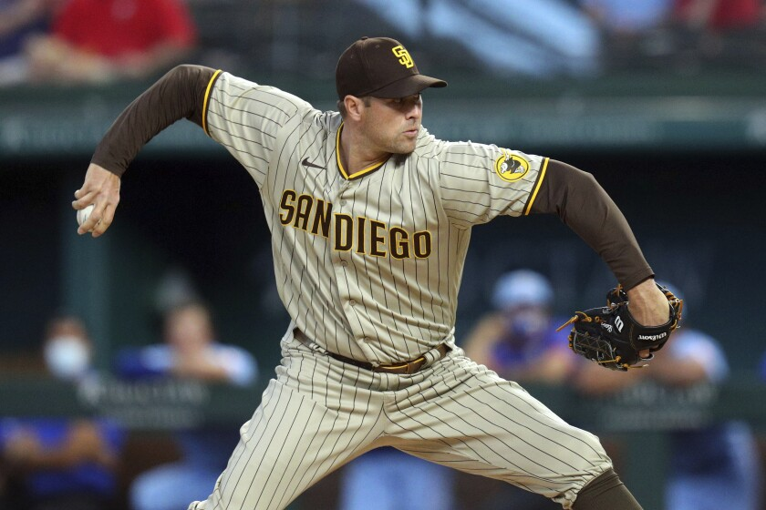 Padres pitcher Craig Stammen throws in the first inning after replacing starting pitcher Adrian Morejon.