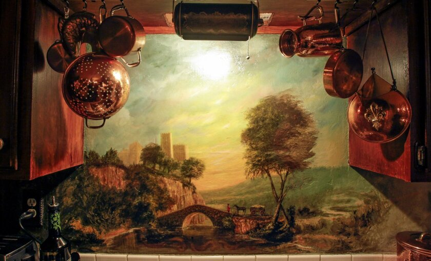 Murals, like this one above the kitchen sink, decorate artist Jennifer Chapman's home.
