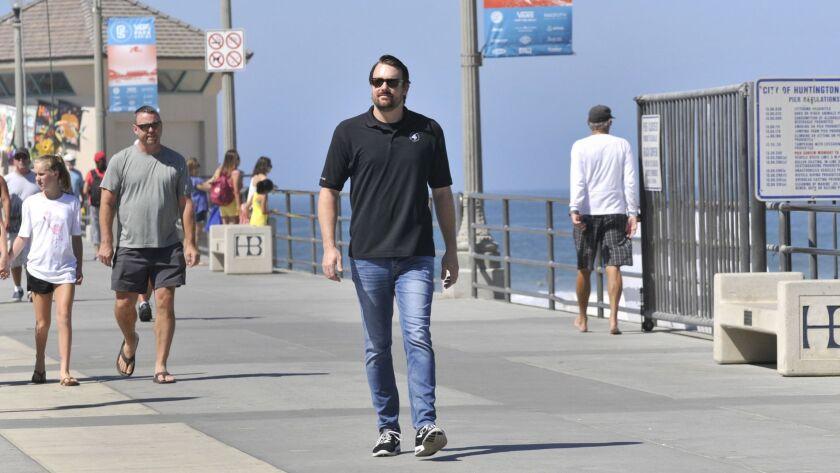 Huntington Beach resident Kevin Elliot, seen on the Huntington Beach Pier, Monday, July 22, 2018, i