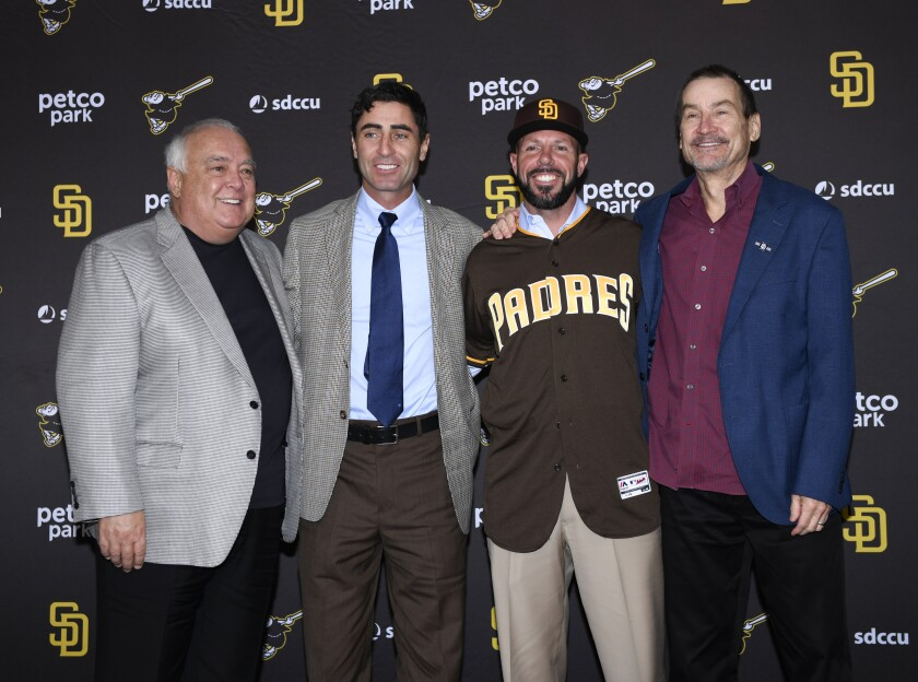 Padres Chairman Peter Seidler, far right, stands with (L-R) Vice Chairman Ron Fowler, GM A.J. Preller and Jayce Tingler