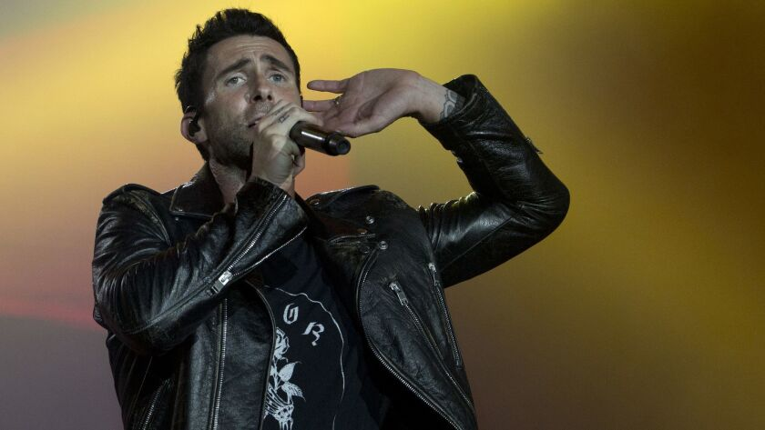 FILE - In this Sept. 16, 2017, file photo, Adam Levine of Maroon 5 performs at the Rock in Rio music