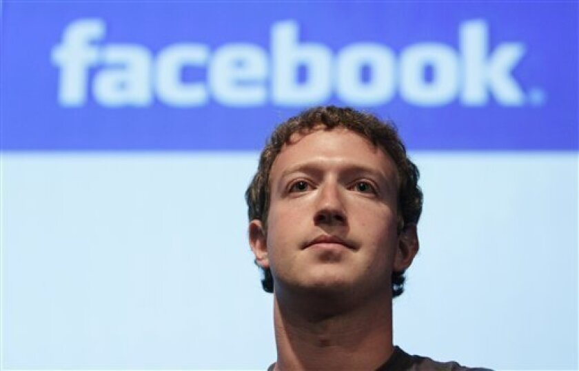 Facebook founder Mark Zuckerberg speaks in the Galileo Auditorium on Microsoft's Silicon Valley Campus in Mountain View, Wednesday, Oct. 13, 2010. (AP Photo/Jeff Chiu)