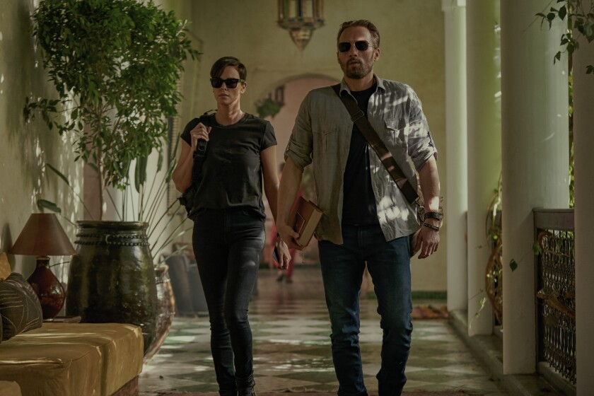 THE OLD OLD GUARD (L TO R) CHARLIZE THERON as ANDY and MATTHIAS SCHOENAERTS as BOOKER in