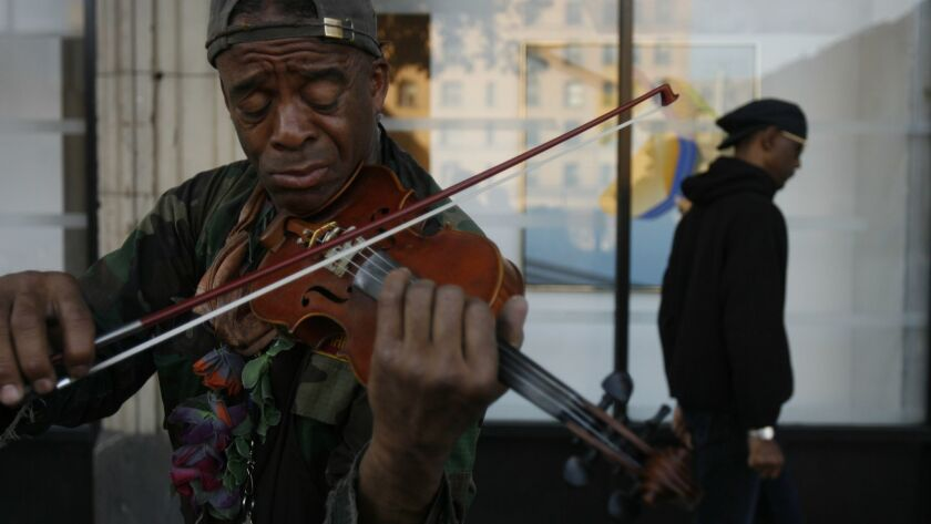 136238.ME.0410.violin.1.RL--Los Angeles, Ca.--Nathaniel Ayers, who is the subject of a feature film,