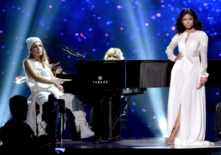Skylar Grey, left, and Nicki Minaj perform at the 2014 American Music Awards.