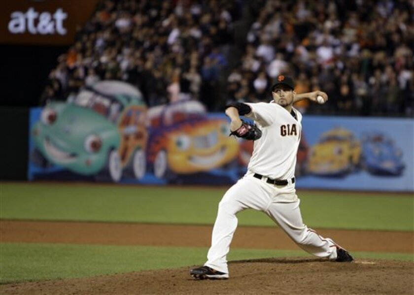 San Francisco Giants' Jonathan Sanchez works against the San Diego Padres during the ninth inning of a baseball game Friday, July 10, 2009, in San Francisco. (AP Photo/Ben Margot)