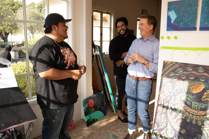 Studio by the Bay artist-in-resident Jose Venegas, left, at his Seaport Village studio space.