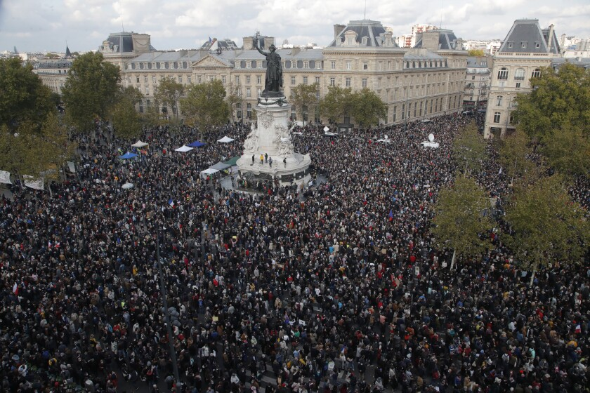Hundreds of people gather on Republique square during a demonstration Sunday in Paris.