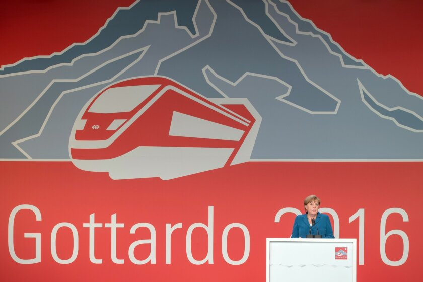 German Chancellor Angela Merkel delivers a speech on the opening day of the Gotthard rail tunnel, t  at the fairground in Pollegio, Switzerland, Wednesday, June 1, 2016. The construction of the 57 kilometer long tunnel began in 1999, the breakthrough was in 2010. (Pablo Gianinazzi/Keystone,Ti-Press