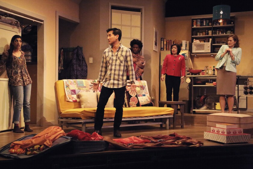 """East West Players performers appear in a scene from """"Washer/Dryer,"""" now playing at the David Hwang Theater in Los Angeles."""