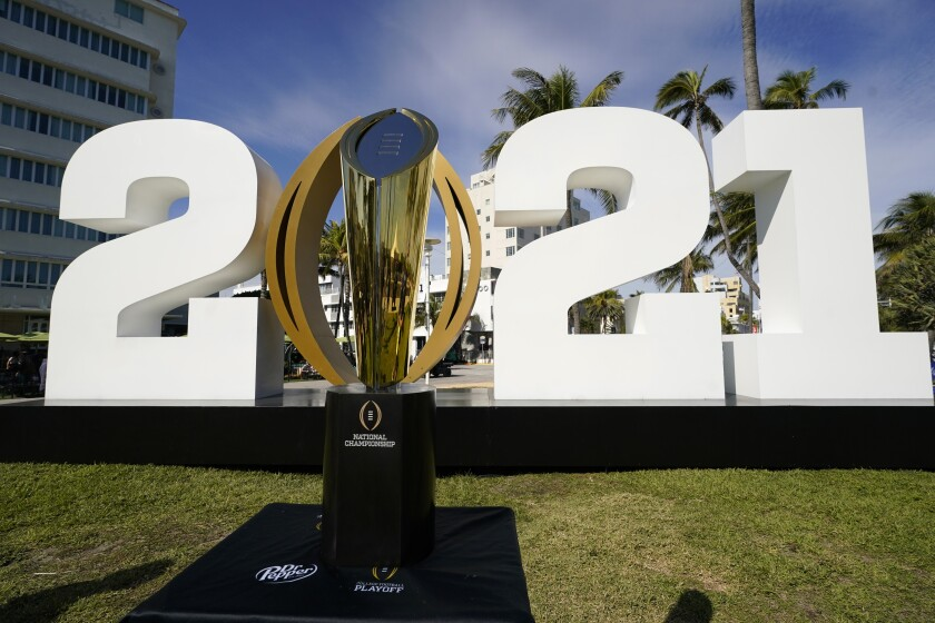 The trophy for the College Football Playoff championship is displayed.