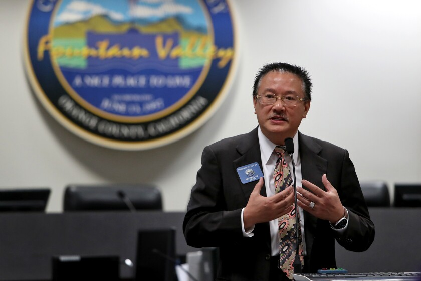 """Fountain Valley Mayor Michael Vo speaks during a news conference on Friday for a community event called """"Walk for Vietnam."""""""