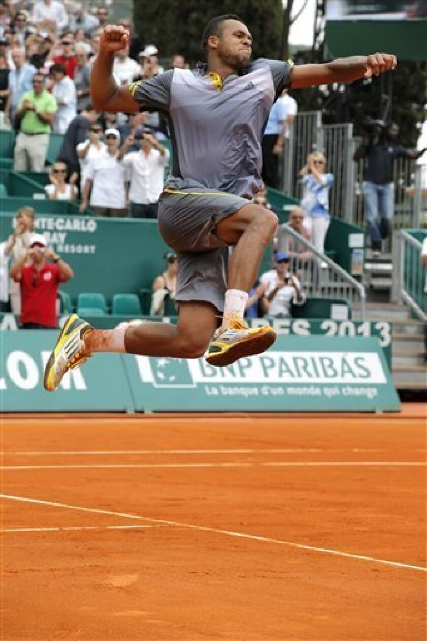 France's Jo-Wilfried Tsonga reacts after defeating Stanislas Wawrinka of Switzerland in their quarter final match of the Monte Carlo Tennis Masters tournament in Monaco , Friday, April 19, 2013. (AP Photo/Lionel Cironneau)
