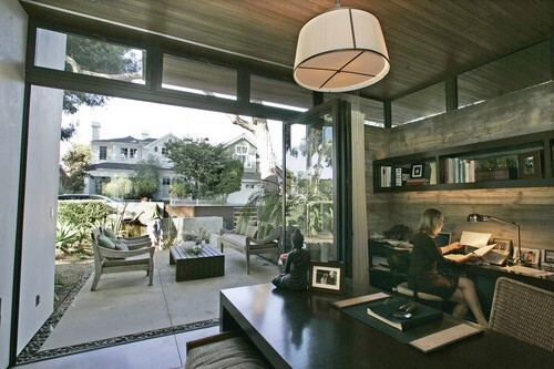 Forget great rooms, walk-in closets and spa-like bathrooms. The home office has become the new staple of the American home. Among the examples of how Southern Californians are incorporating work spaces into their homes: the Manhattan Beach residence of architect Grant Kirkpatrick. Here, wife Shaya works in her home office, where wide doors open to the front patio.