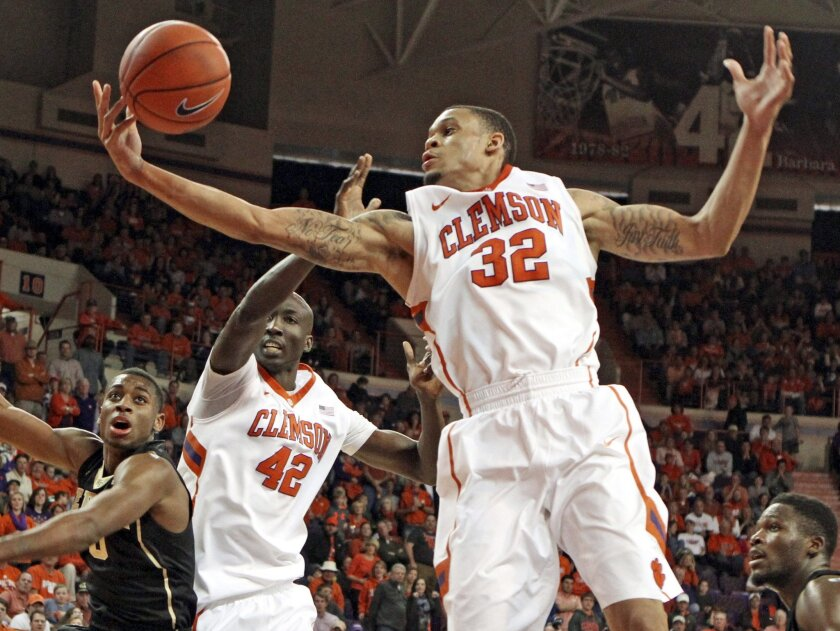 FILE - In this Jan. 18, 2014, file photo, Clemson's K.J. McDaniels grabs a rebound during the second half of an NCAA college basketball game against Wake Forest in Clemson, S.C. A person familiar with the situation says Clemson junior McDaniels is leaving school for the NBA draft. The person spoke with The Associated Press on condition of anonymity because neither McDaniels nor Clemson has announced the decision. (AP Photo/The Independent-Mail, Mark Crammer, File) THE GREENVILLE NEWS OUT, SENECA NEWS OUT