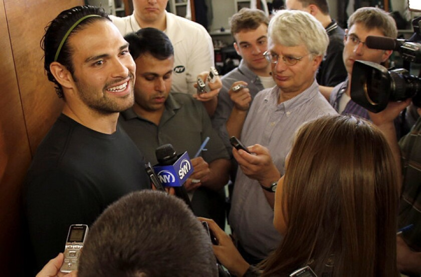 Jets quarterback Mark Sanchez talks to reporters on Thursday at the team's practice facility in Florham Park, N.J.
