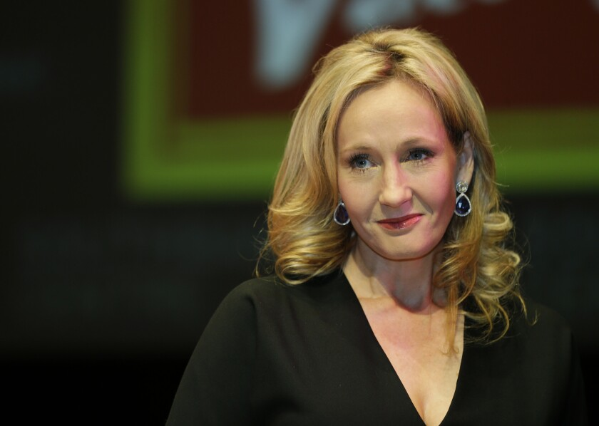 """J.K. Rowling poses for photographers during the unveiling of her book """"The Casual Vacancy"""" at the Southbank Center in London on Sept. 27, 2012."""