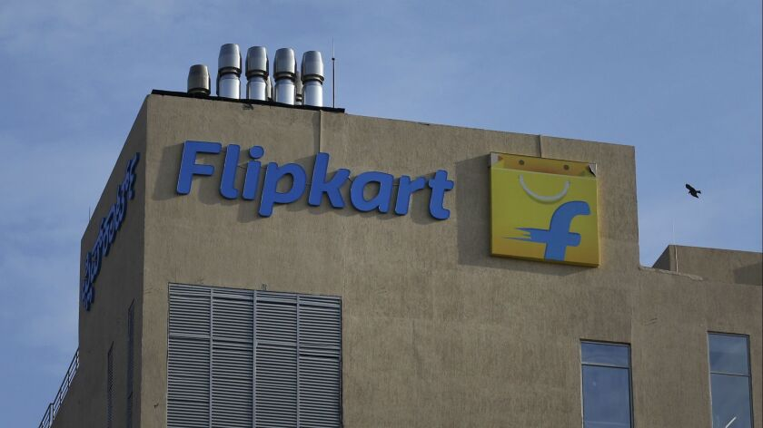 A bird flies over the Flipkart headquarters in Bangalore, India, Wednesday, May 9, 2018. Walmart is