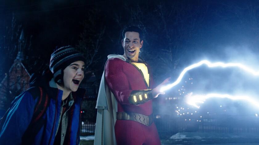 (L-r) JACK DYLAN GRAZER as Freddy Freeman and ZACHARY LEVI as Shazam in New Line Cinema?s action adv