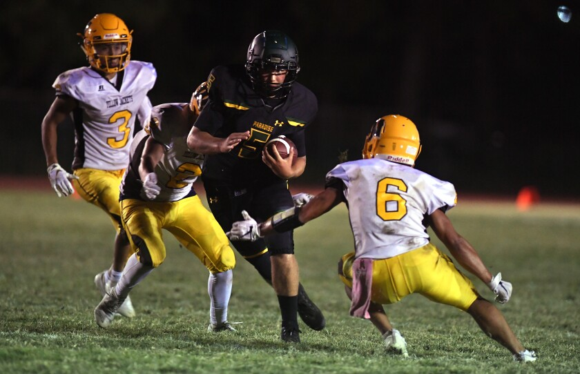 Paradise quarterback Danny Bettencourt carries the ball against Williams in August.