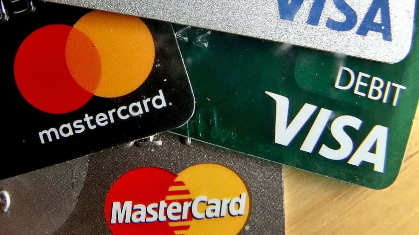 In this Feb. 20, 2019, logos for credit cards are visible on the cards in Zelienople, Pa. On Tuesday