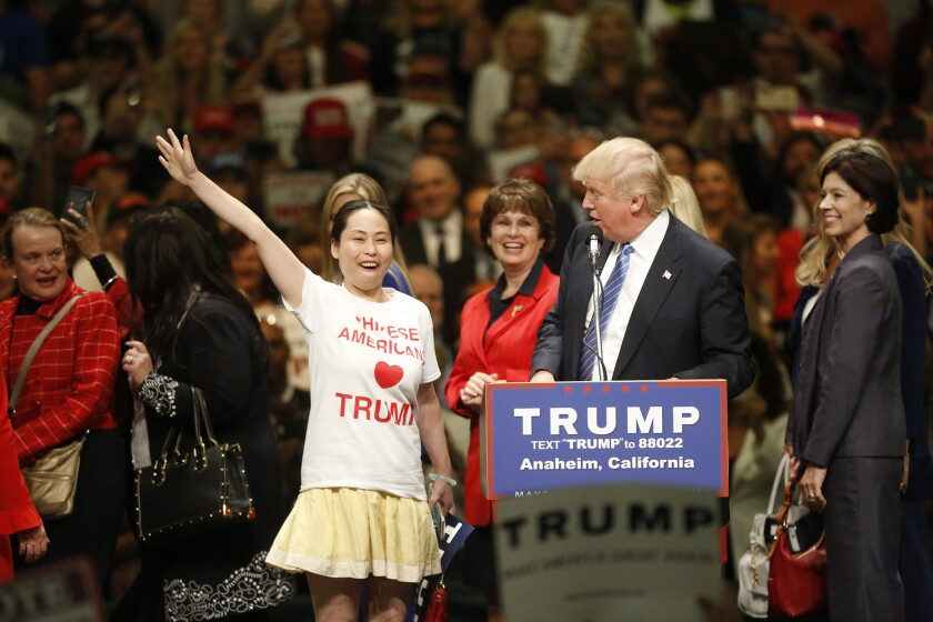 Ling Zeng, a Chinese American Trump supporter takes the stage with the Republican candidate Wednesday at the Anaheim Convention Center.