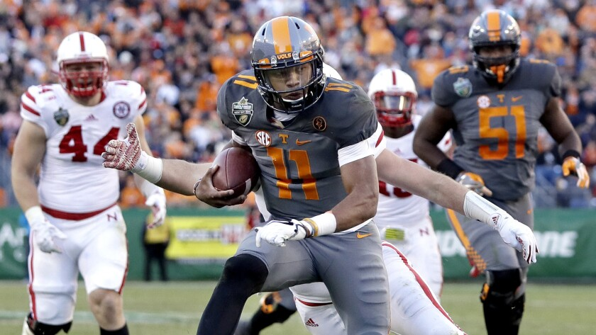 Tennessee quarterback Joshua Dobbs (11) scores a touchdown against Nebraska on a 10-yard run during the first half Friday.