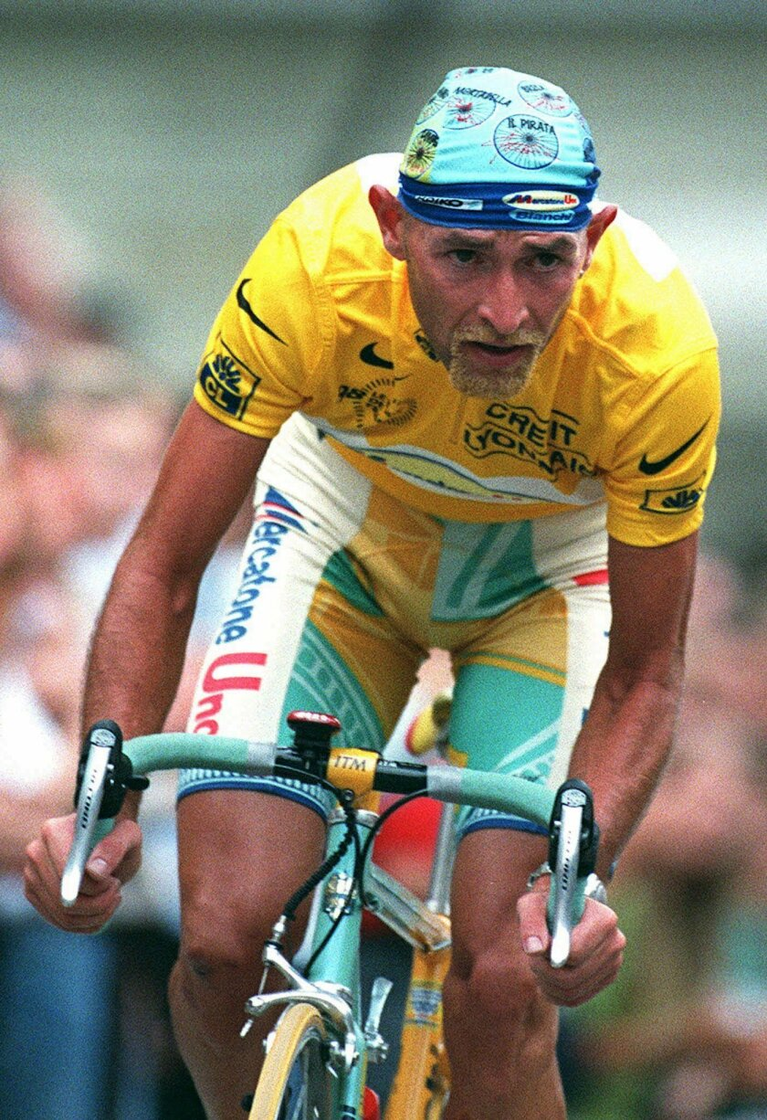 "FILE -- In this Aug. 4, 198 file photo, cycling racer Marco Pantani of Italy, with his jellow jacket of winner of the Tour de France'98, in action during the exhibition cycling race ""A travers Lausanne"", in Lausanne, Switzerland. Italian prosecutors have reopened an investigation into the death of cyclist Marco Pantani after his family presented evidence contending the former Tour de France winner was murdered. Pantani, who won both the Giro d'Italia and Tour de France in 1998, was found dead in a Rimini hotel room on Feb. 14, 2004. A coroner ruled he died from an overdose of cocaine. (AP Photo/Fabrice Coffrini, FILE)"