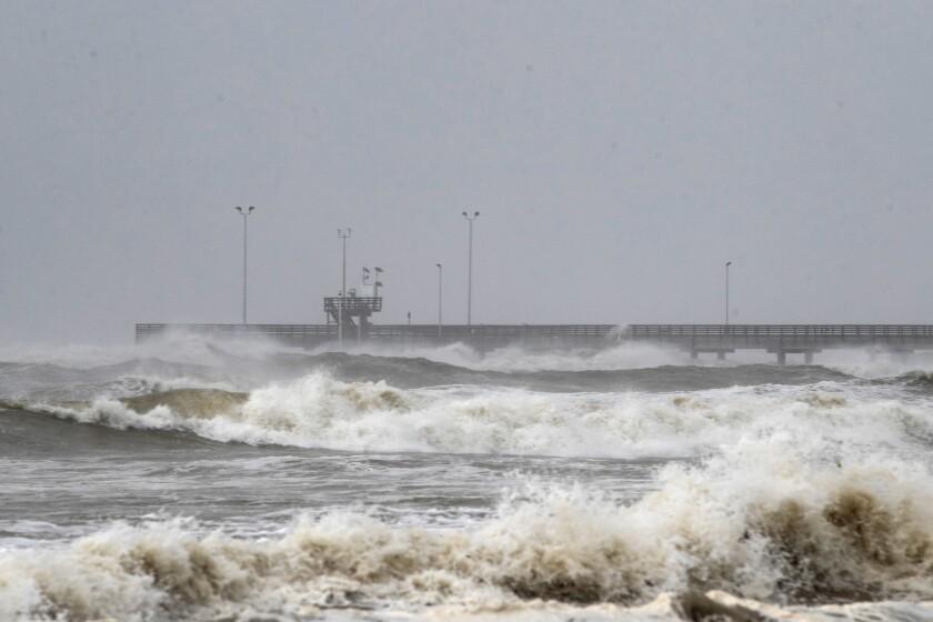 Rough waves crash around Bob Hall Pier in Corpus Christi, Texas, as Hurricane Hanna approaches land Saturday.