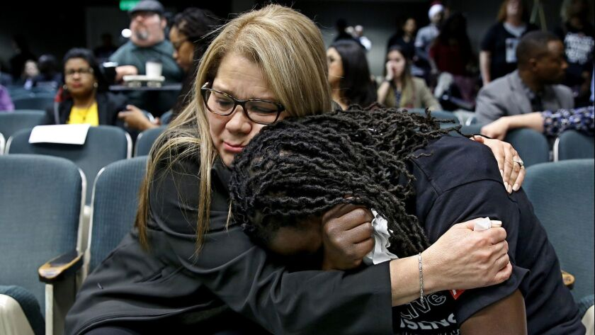 Elizabeth Medrano Escobedo, mother of Christian Escobedo, who was killed by Los Angeles police, comforts Ciara Hamilton, whose cousin Diante Yarber was killed by Barstow police, during a hearing to restrict police use of deadly force in Sacramento, Calif. on April 9.