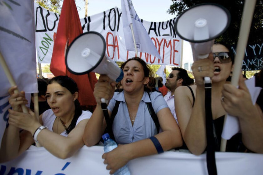 Protester shout slogans during an anti-bailout rally Tuesday outside parliament in Nicosia, the capital of Cyprus.