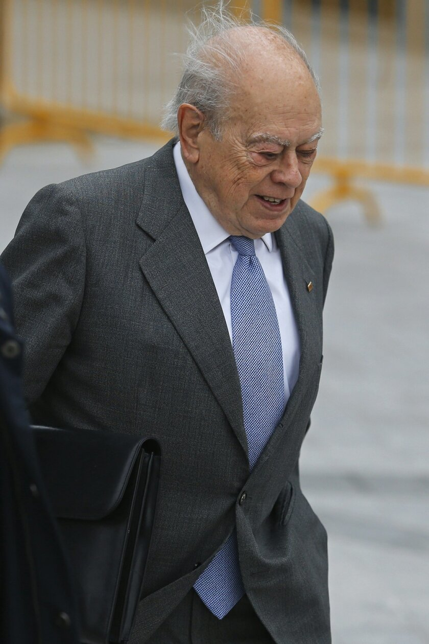 Catalan former President Jordi Pujol arrives to the national court to testify after being charged for the crime of money laundering, in Madrid, Wednesday, Feb. 10, 2016. Pujol who founded Catalonia's Convergence party that governs the economically powerful region, was Catalonia region's president f