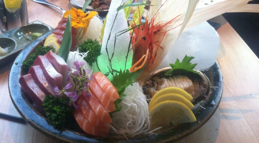 A sashimi platter at Blue Ocean has fresh seafood and shellfish, as well as amusing twinkling LED lights hidden under snow-cone sculptures.